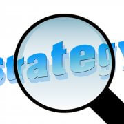 Magnifying glass over strategy